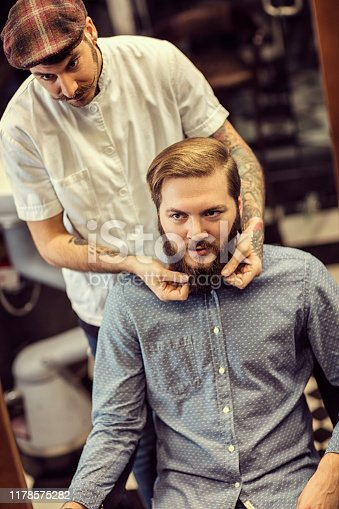 istock Barber man grooming with scissors of real hipster 1178575282