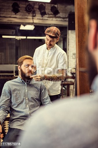 istock Barber man grooming with scissors of real hipster 1178575318