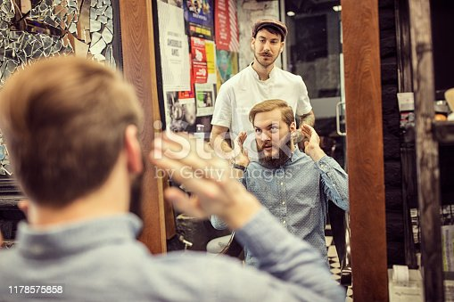 istock Barber man grooming with scissors of real hipster 1178575858