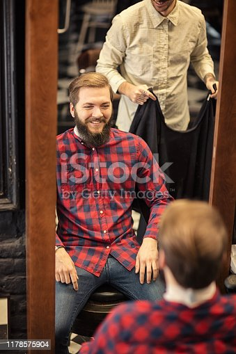 istock Barber man grooming with scissors of real hipster 1178575904