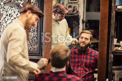 istock Barber man grooming with scissors of real hipster 1178575968