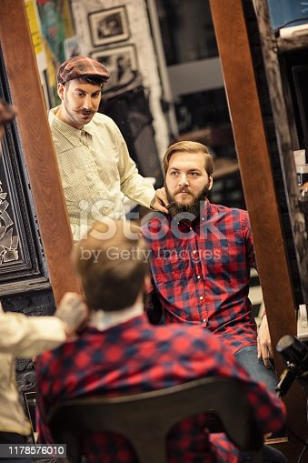 istock Barber man grooming with scissors of real hipster 1178576010