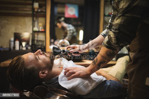istock Barber Powdering Client's Neck 685907900