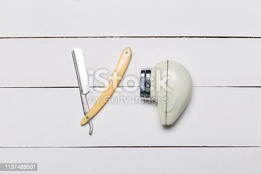 1041901666 istock photo Barber razor and Retro electric shave machine on wooden background 1137488501