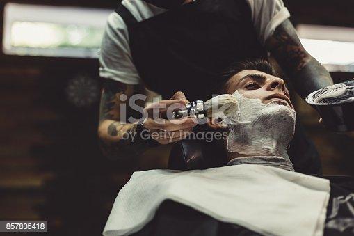 istock Barber shaving client 857805418