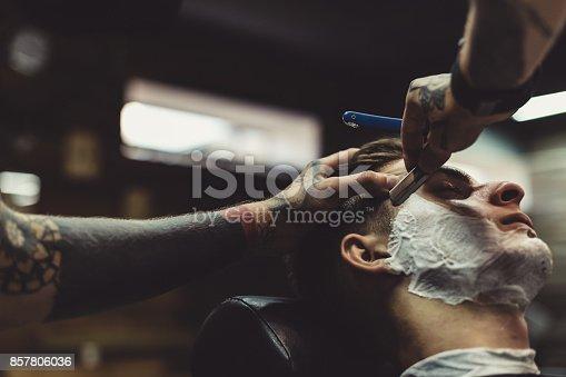 istock Barber shaving client 857806036
