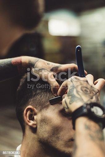 istock Barber shaving client 857808390