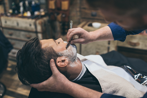 istock Barber shaving customer 826307544