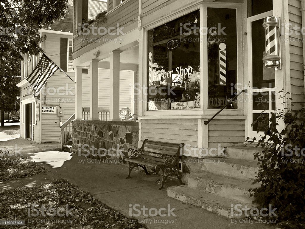 Barber shop and flag - sepia stock photo