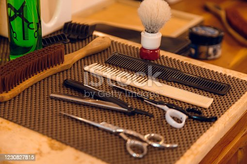 834518170 istock photo Barber shop equipment. Professional hairdressing tools on table. Mens grooming tools 1230827815