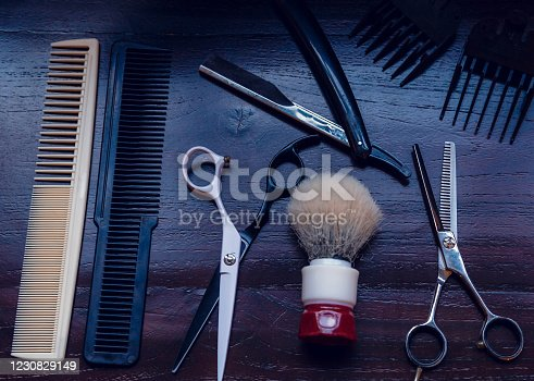 834518170 istock photo Barber shop equipment. Professional hairdressing tools on table. Mens grooming tools 1230829149