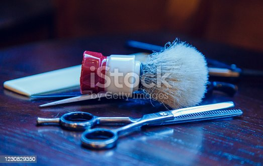 834518170 istock photo Barber shop equipment. Professional hairdressing tools on table. Mens grooming tools 1230829350