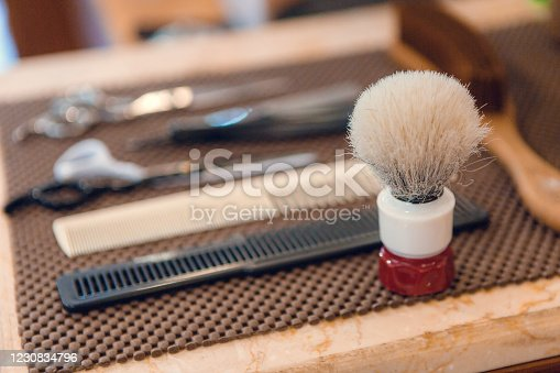 834518170 istock photo Barber shop equipment. Professional hairdressing tools on table. Mens grooming tools 1230834796