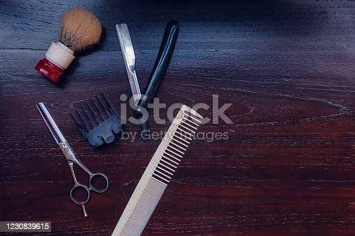 834518170 istock photo Barber shop equipment. Professional hairdressing tools on table. Mens grooming tools 1230839615
