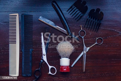 834518170 istock photo Barber shop equipment. Professional hairdressing tools on table. Mens grooming tools 1230844744