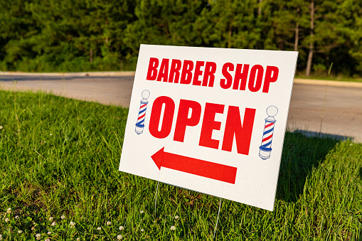 istock Barber Shop Open sign, outside with copy space 1252951526