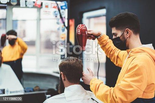 Businessman in barber shop