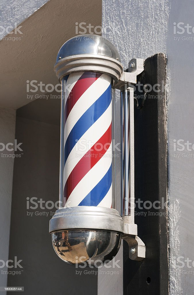 Barber Shop Pole Sign in Classic Stripe Design Outside Storefront stock photo