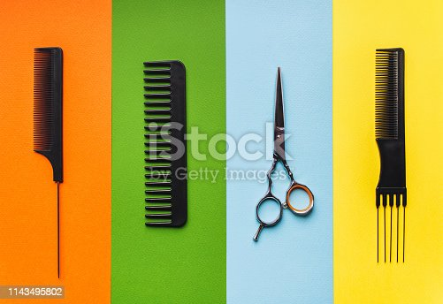 696318954 istock photo Barber shop. Tools hairdresser on the background of pastel paper in the form of multi-colored stripes. 1143495802