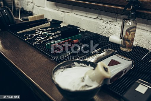 1126324804 istock photo Barber shop tools on the table. Close up view shaving foam 937431454