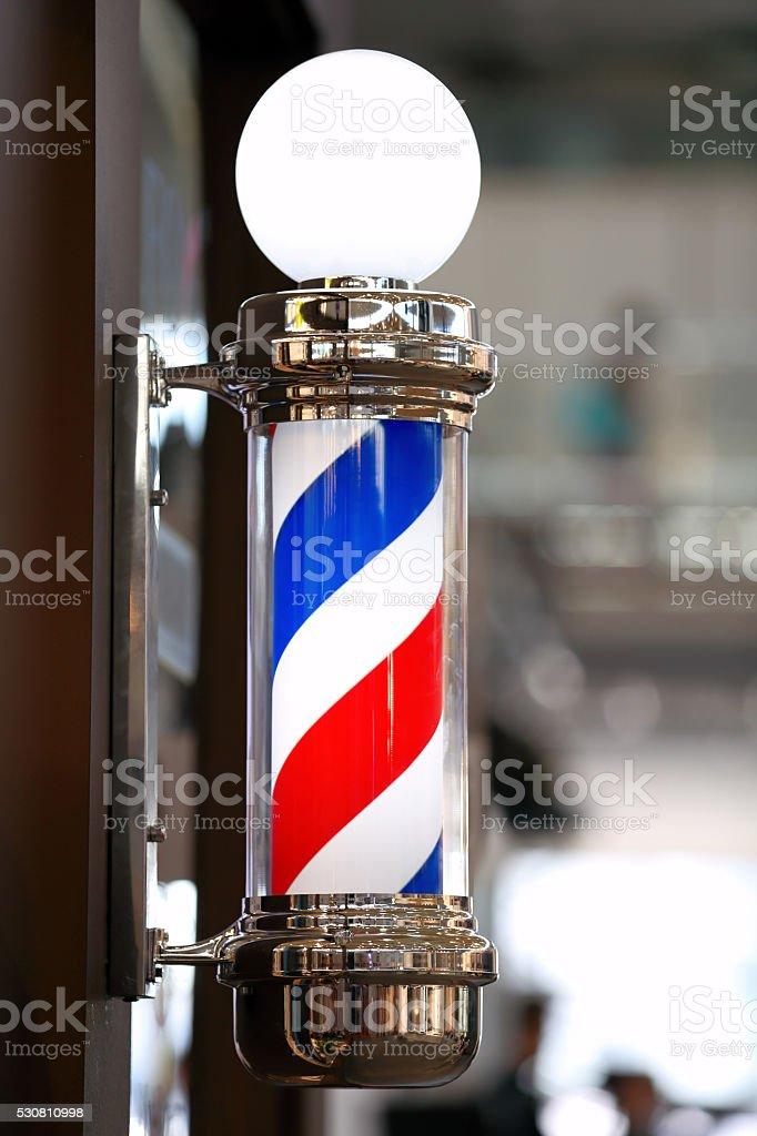 Barber shop vintage pole stock photo
