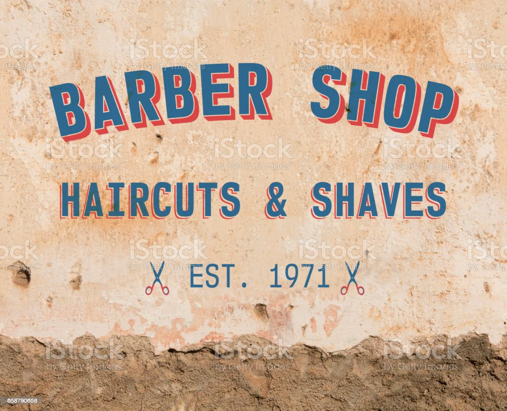 Barber sign on grunge wall stock photo