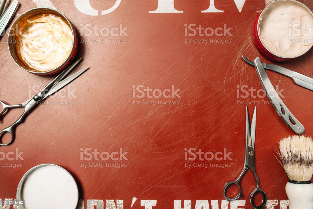 Barber tools frame on red background flat lay stock photo