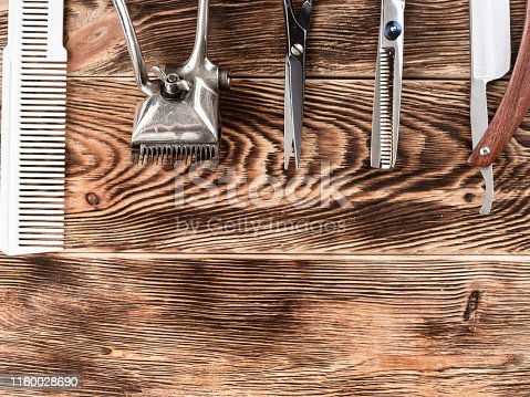 868725110istockphoto Barber Tools On Wooden Background 1160028690