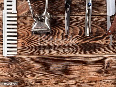 868725110istockphoto Barber Tools On Wooden Background 1160028701