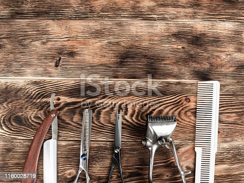 868725110istockphoto Barber Tools On Wooden Background 1160028719