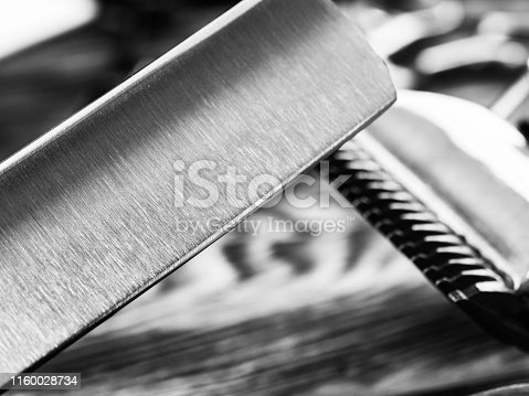 868725110istockphoto Barber Tools On Wooden Background 1160028734