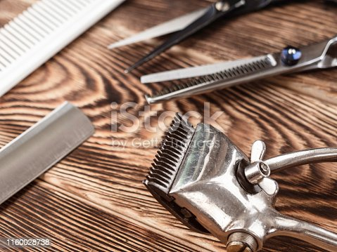 868725110istockphoto Barber Tools On Wooden Background 1160028738