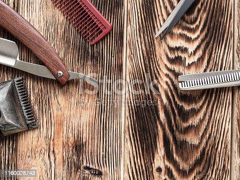 868725110istockphoto Barber Tools On Wooden Background 1160028743