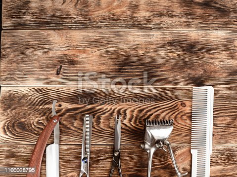 868725110istockphoto Barber Tools On Wooden Background 1160028795