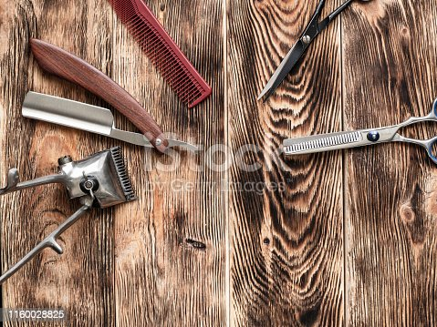868725110istockphoto Barber Tools On Wooden Background 1160028825