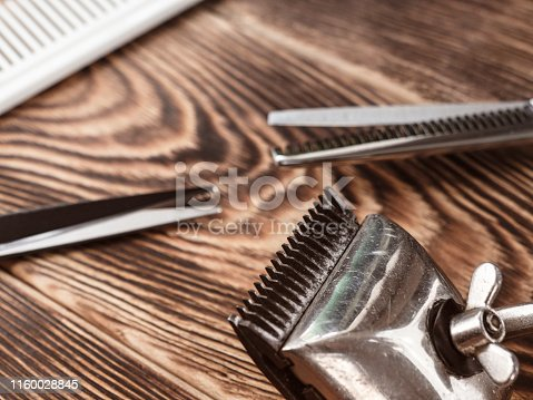 868725110istockphoto Barber Tools On Wooden Background 1160028845