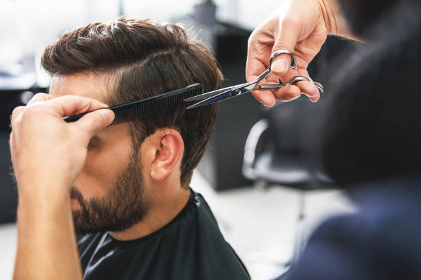 barber using scissors and comb - hairstyle stock photos and pictures