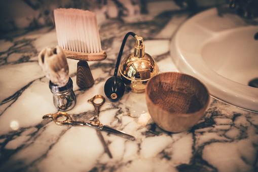 Barber vintage tools for beard grooming on marble sink