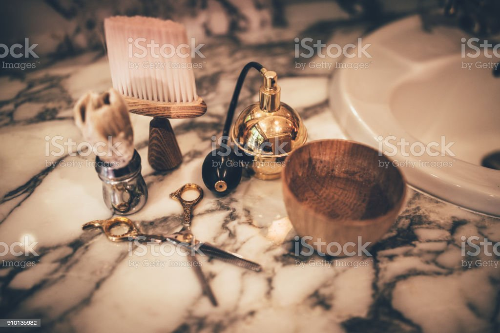 Barber vintage tools for beard grooming on marble sink stock photo