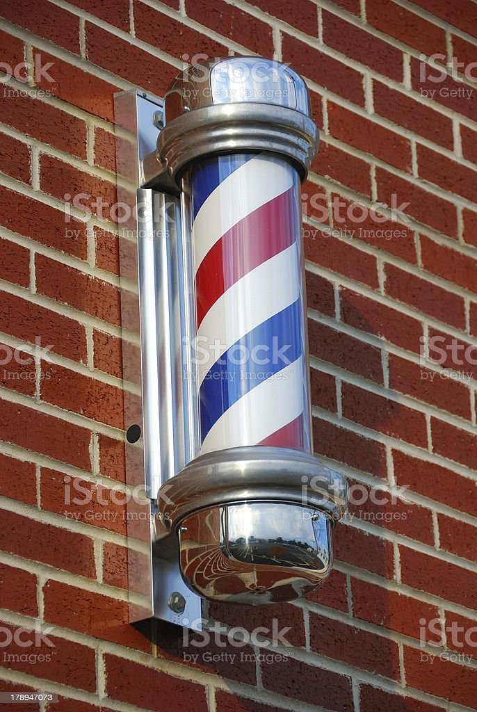 Barber's Pole on Red Brick stock photo