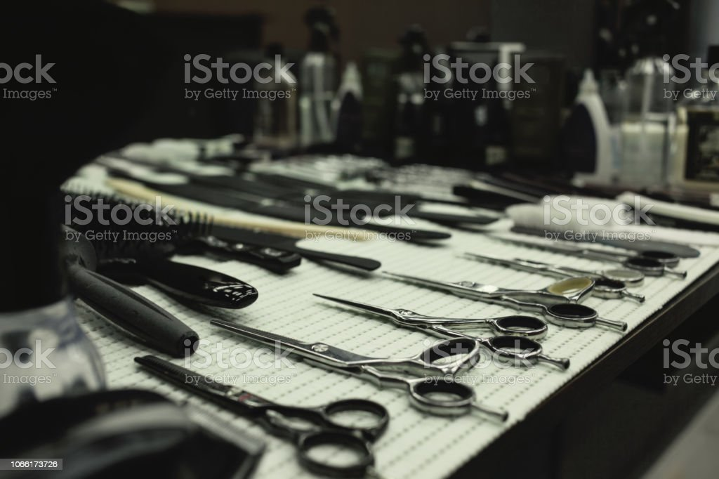 Barber's work table with a set of scissors stock photo