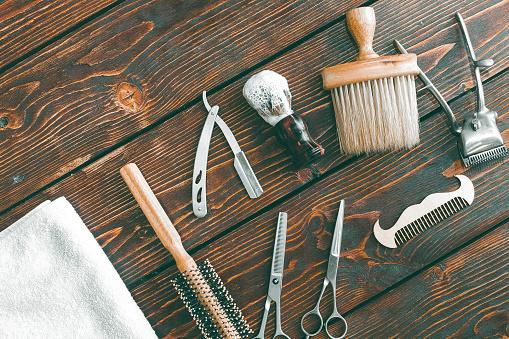 Barbershop accessories on wooden table. Barbershop background copy space