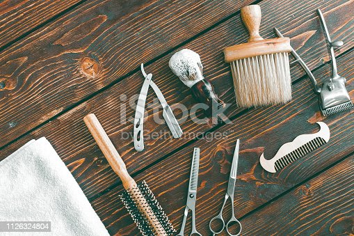 istock Barbershop accessories on wooden table. Barbershop background copy space 1126324804