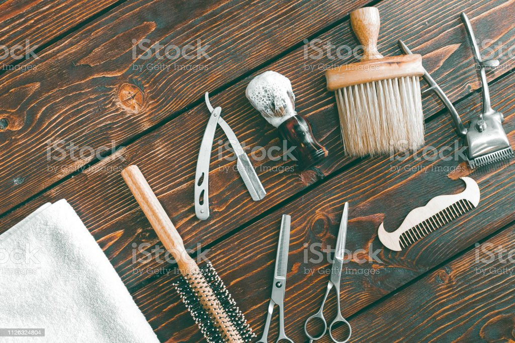 Barbershop accessories on wooden table. Barbershop background copy space stock photo