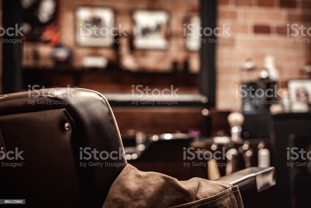 Barbershop chair and blurred background stock photo