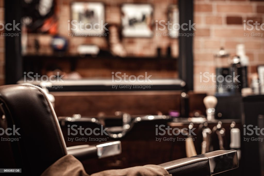 Barbershop chair and blurred background royalty-free stock photo
