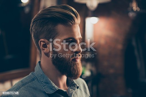 698023272 istock photo Barbershop concept. Profile side portrait of attractive severe brutal red bearded young guy. He has a perfect hairstyle, modern stylish haircut 939970748