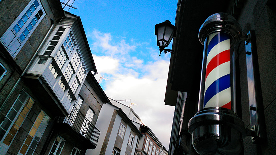 Barbershop old fashioned symbol in old town street