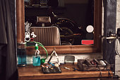 istock Barbershop tools on wooden brown table. Accessories for shaving and haircuts on the table. 1137576225