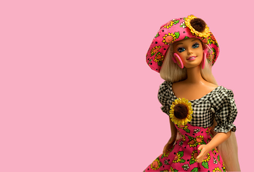 Prague, Czech Republic - February 19, 2016.  Barbie toy doll isolated on pink background.